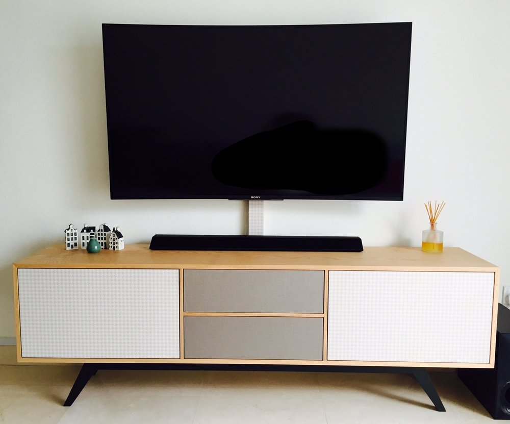 Sleek and fuss free: We kept the electrical wiring within the same laminate casing (just below the TV screen) to achieve a tidy look.