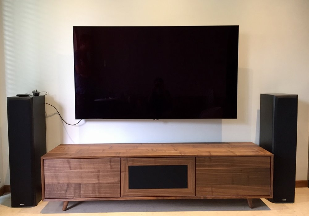 A Walnut veneer TV console with three compartments. It sure looks like solid wood.