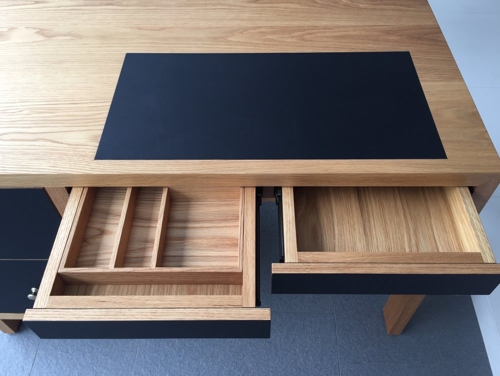Stationary is nicely kept in this work desk, built with solid Oak wood and EDL's Fenix Black laminate.