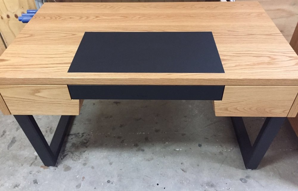 Another desk for another room. Stylish, simple and in line with the theme of the home. Build with solid Oak wood, black leather insert, on power coasted steel legs.