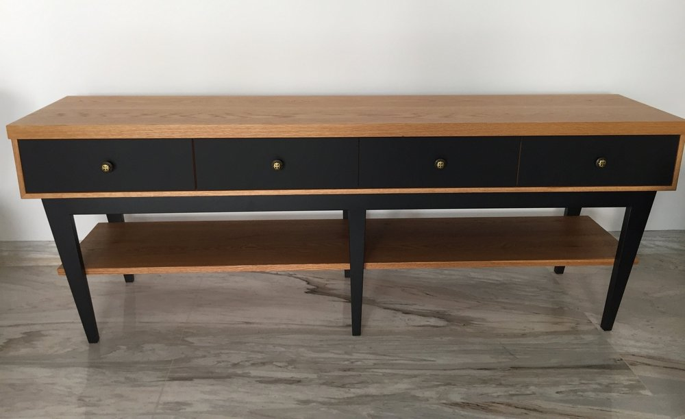 A sideboard for the living room using EDL's Fenix Black laminate and solid Oak wood. We designed 4 drawers on slant legs to give this classic piece an edge.