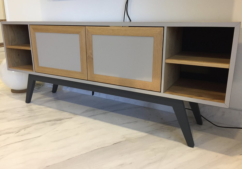 This cute sized TV console for the small apartment is able to bring both the living and dining space together.
