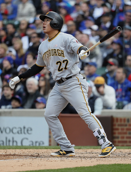 Jung-Ho Kang watches his homer that clinched the game for the Buccos today. Courtesy Jonathan Daniel/Getty Images.