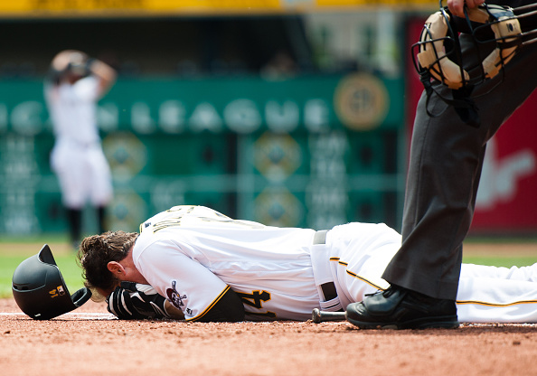 Ryan Vogelsong on the ground after getting hit in the face with a pitch from Jordan Lyles. Courtesy Justin Berl/Getty Images.