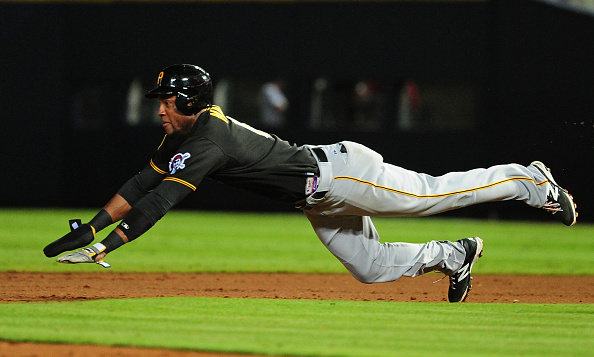 Marte sliding into his phone booth. Courtesy Scott Cunningham/Getty Images.