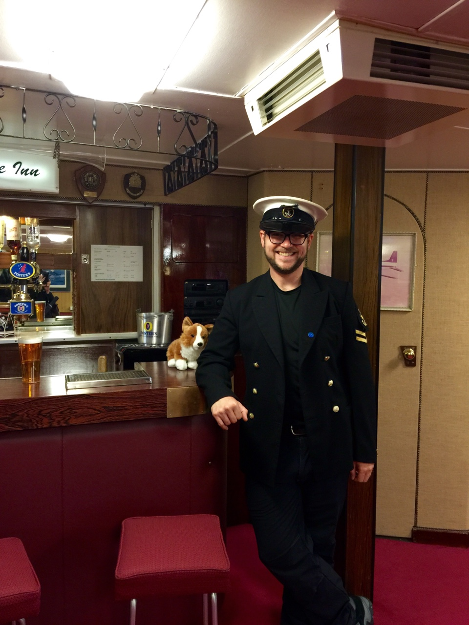Edinburgh, Scotland    Manning the bar from the Royal Yacht Brittania with my trusty stuffed corgi, Scruffles.
