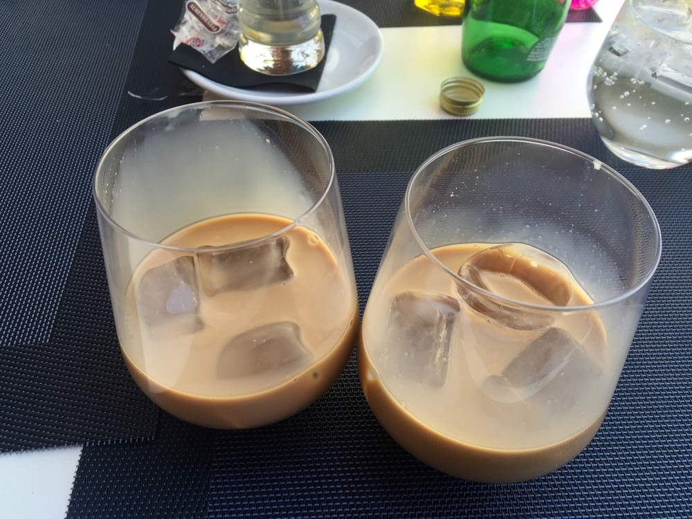 I like my coffee black as night, but I found a drink in Spain that may have just changed my mind a little:    Meet café Bombon con hielo - normally served hot as a shot of espresso with condensed milk, then we added ice to combat the midday heat. Fantastic!