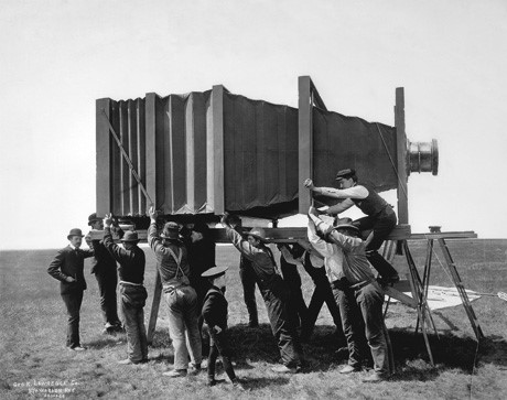 "The Hitherto Impossible: The Mammoth    In 1900, Chicago and Alton Railroad wanted to take a large panoramic photo of an entire train.  George Lawrence, whose company's tagline read ""The Hitherto Impossible in Photography Is Our Specialty,"" came forward. He designed and built the ""Mammoth,"" a massive camera that weighed 1,400 pounds (635 kg) and required fifteen operators! The resulting 8.5ft x 4.5ft (2.6m x 1.4m) picture, though initially called a fake by critics, was later awarded ""Grand Prize of the World for Photographic Excellence""."