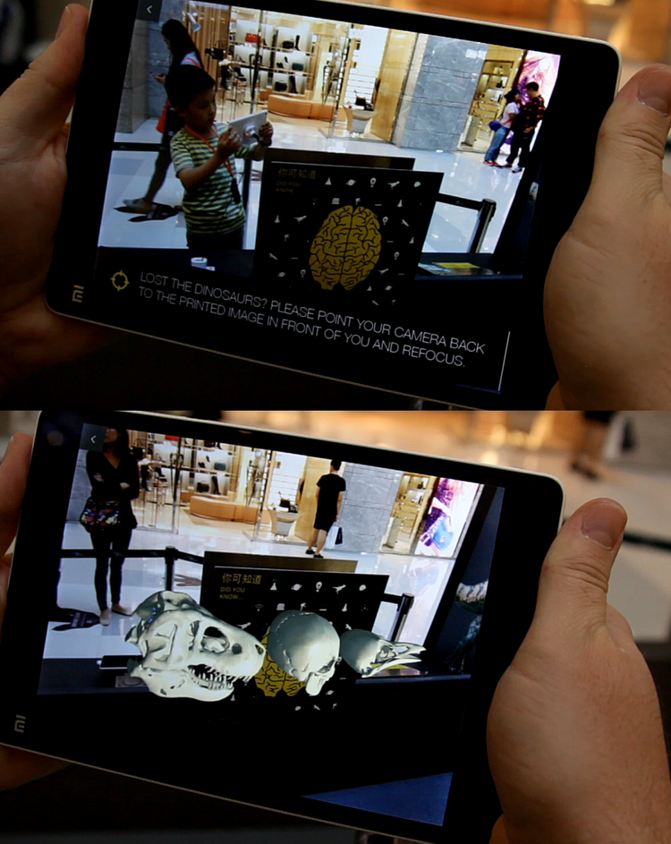 The 3D animation is triggered by pointing the device at the printed image, using a mobile application developed by INDE