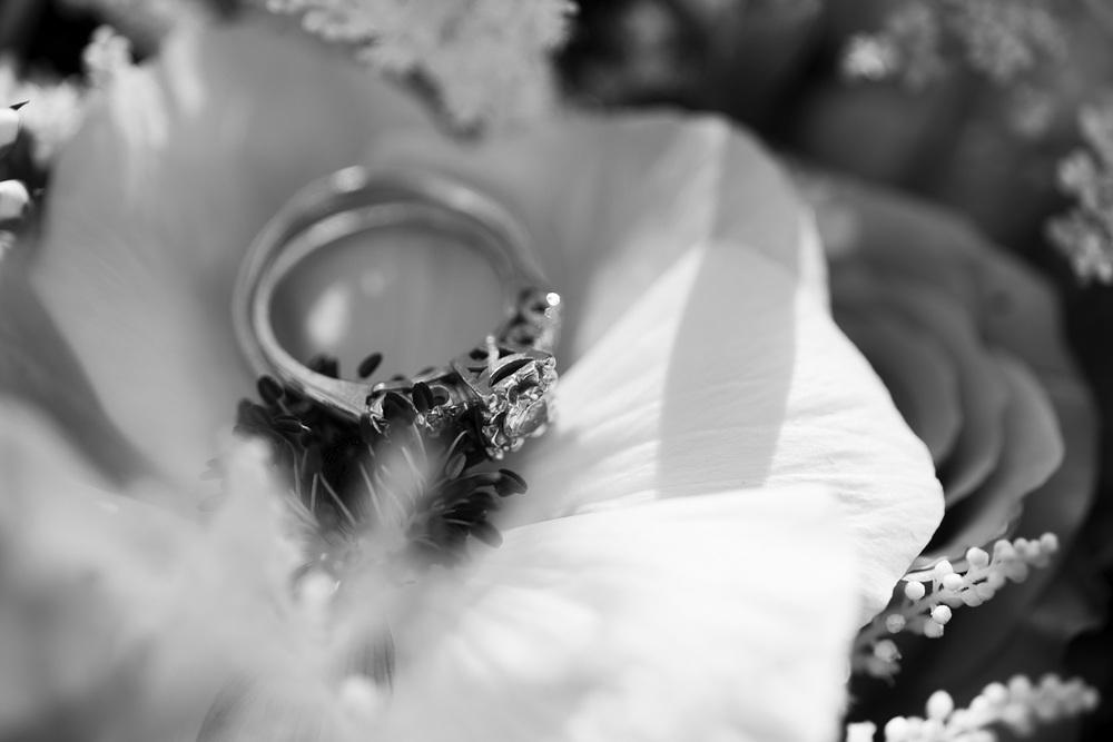 rings wedding bands flowers details closeup