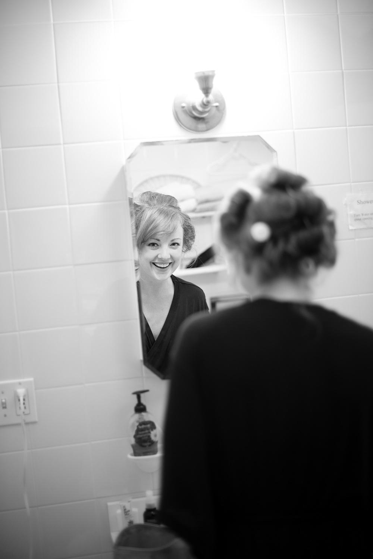 bride mirror smile getting ready preparing portrait candid