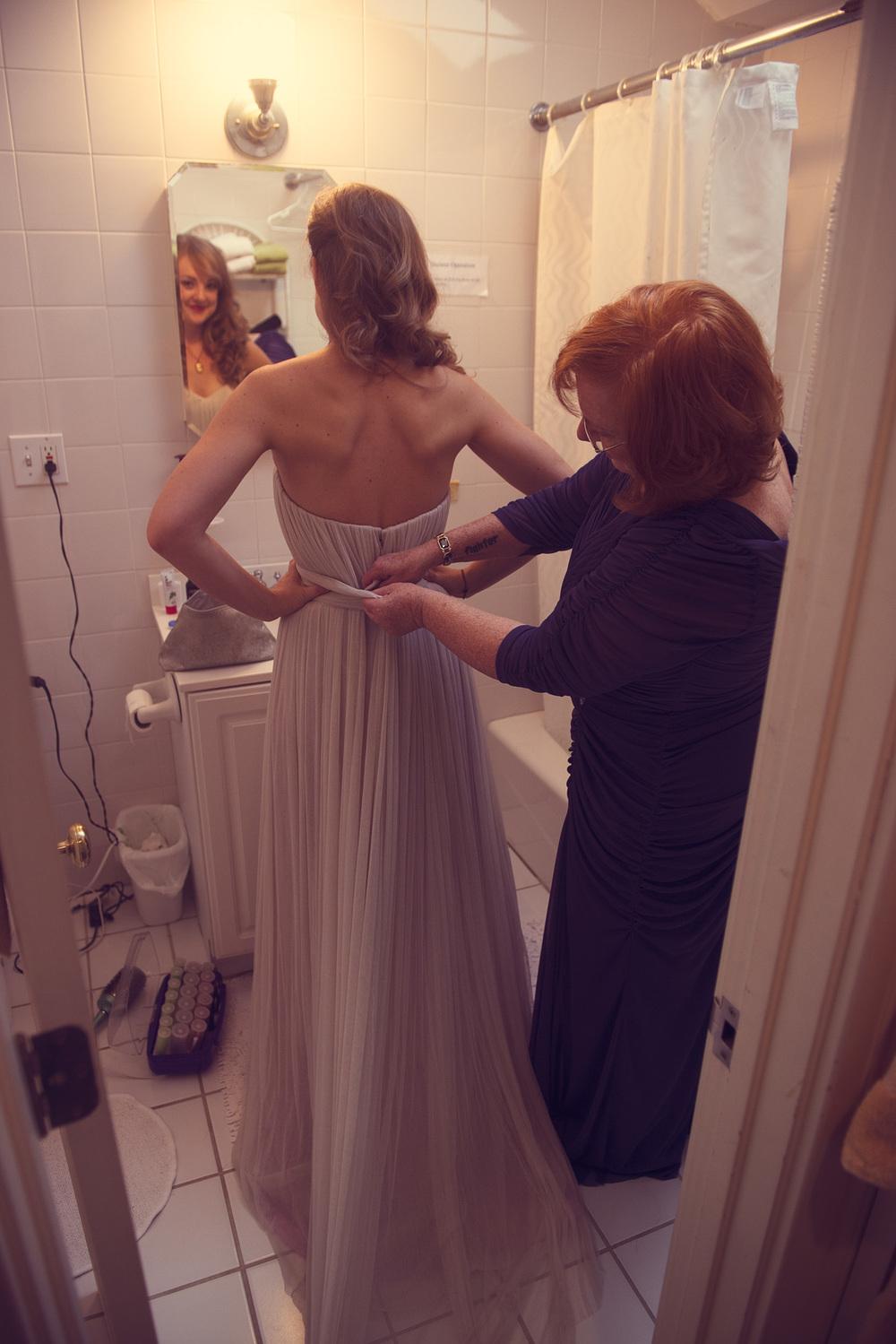 bride wedding dress mother daughter helping
