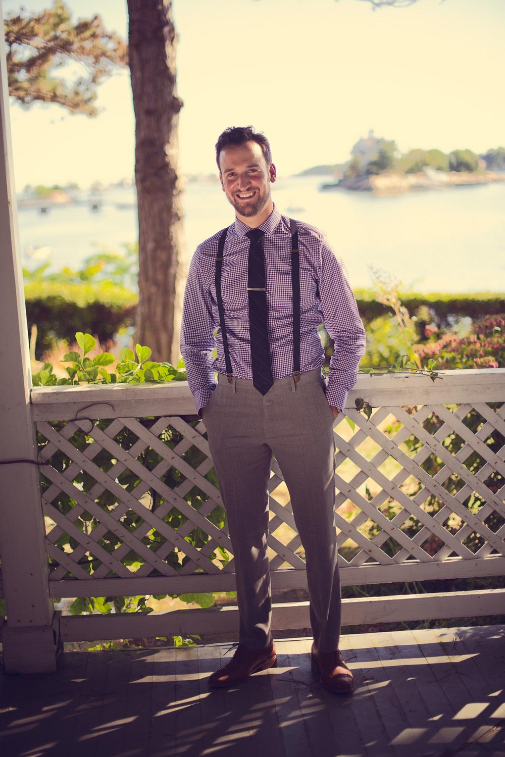 groom help tie suit portrait porch smile