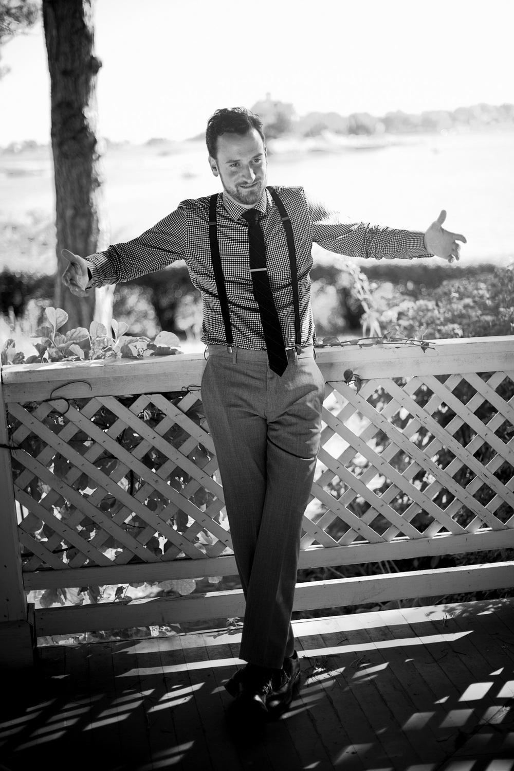 groom help tie suit portrait porch smile swagger