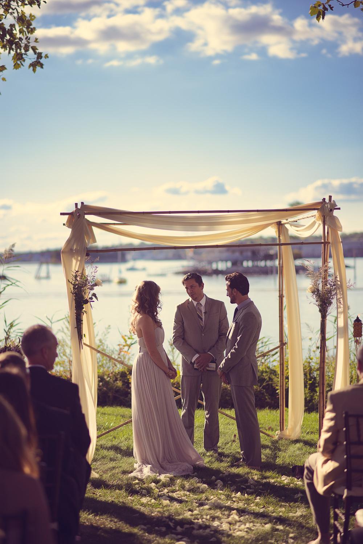 sunshine bride groom alter wedding arch coast ocean New England ceremony