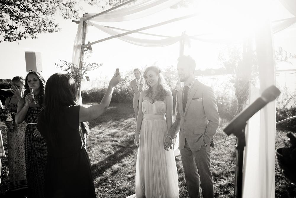 bride groom cleansing sage emotion wedding arch coast ocean New England