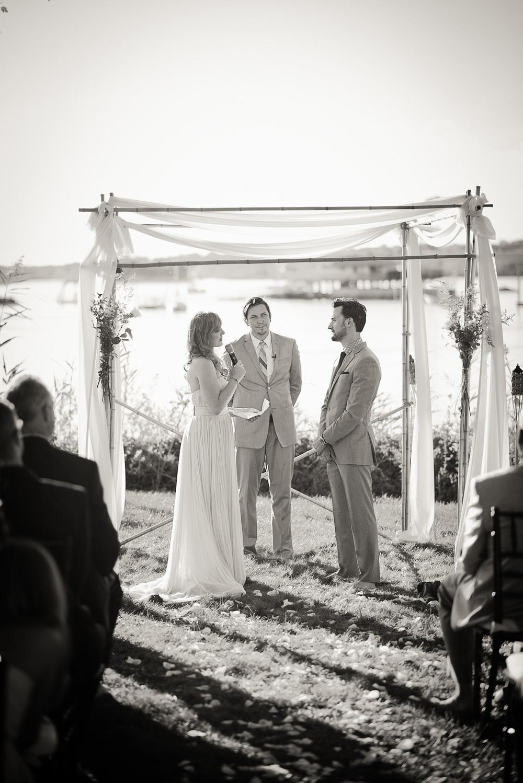 bride groom vows wedding arch coast ocean New England