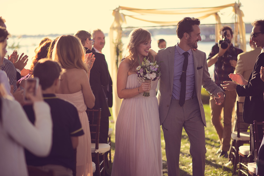 bride groom joy excitement husband wife celebration wedding arch coast ocean New England