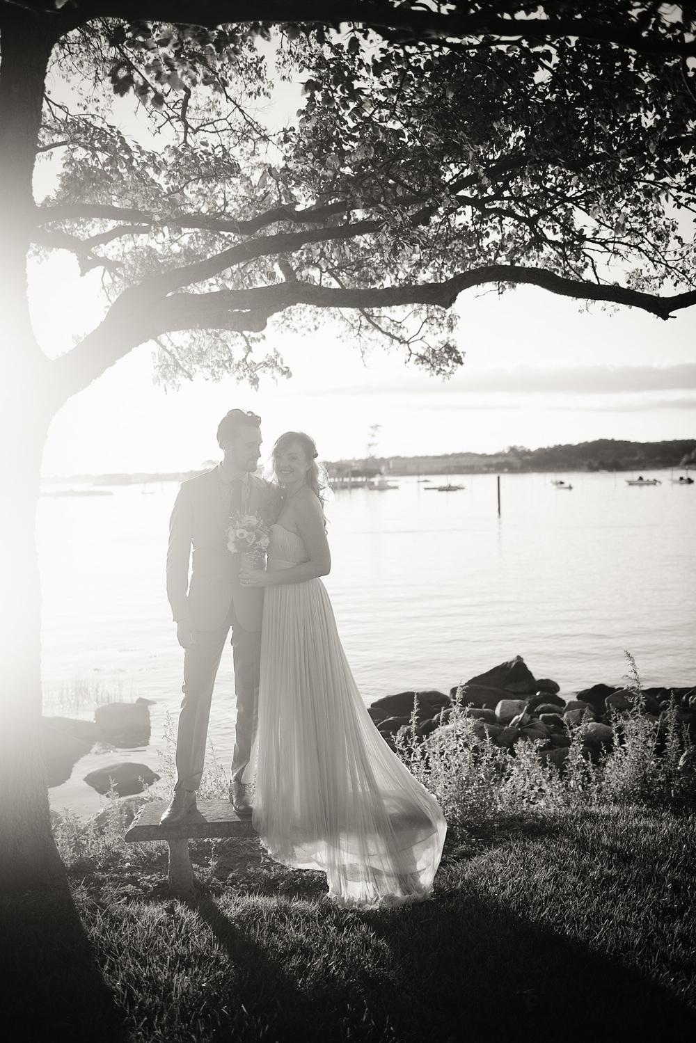bride groom silhouette sunset bench tree beautiful husband wife coast ocean New England