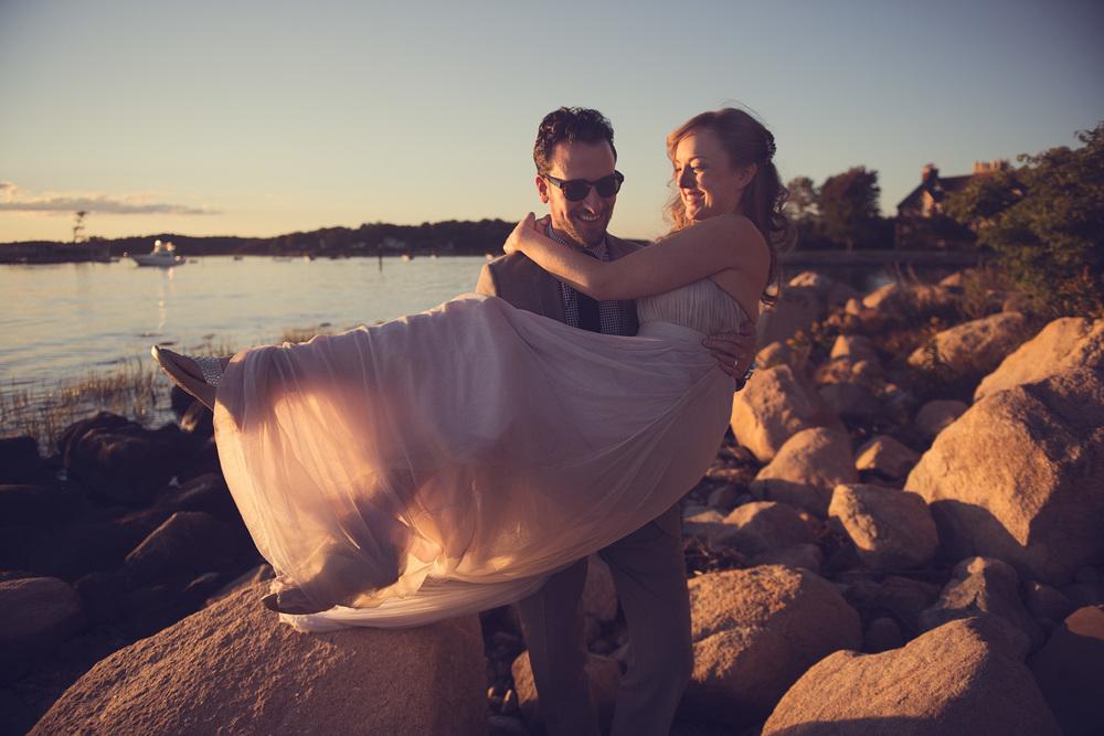 bride groom carry portrait sunset wife THPHOTO boulders rocks beach New England Connecticut