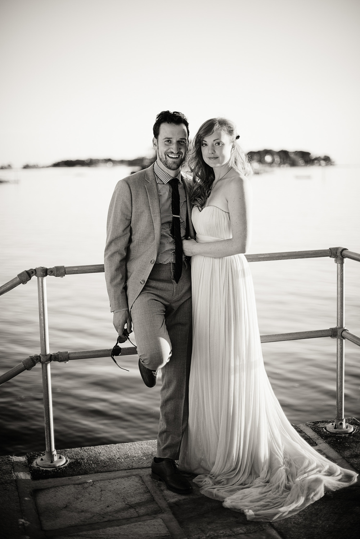 bride groom portrait sunset wife THPHOTO New England Connecticut ocean coast picturesque embrace love