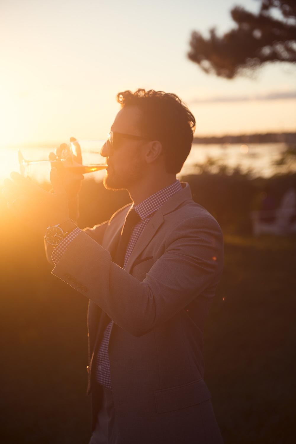 groom portrait sunset glass drink sun flare THPHOTO
