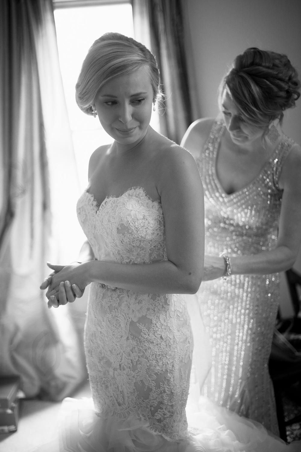 bride mother daughter tears dress window light