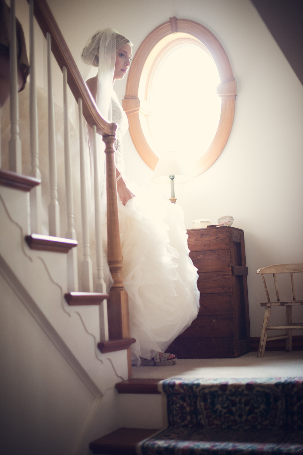 bride coming down stairs dress window light