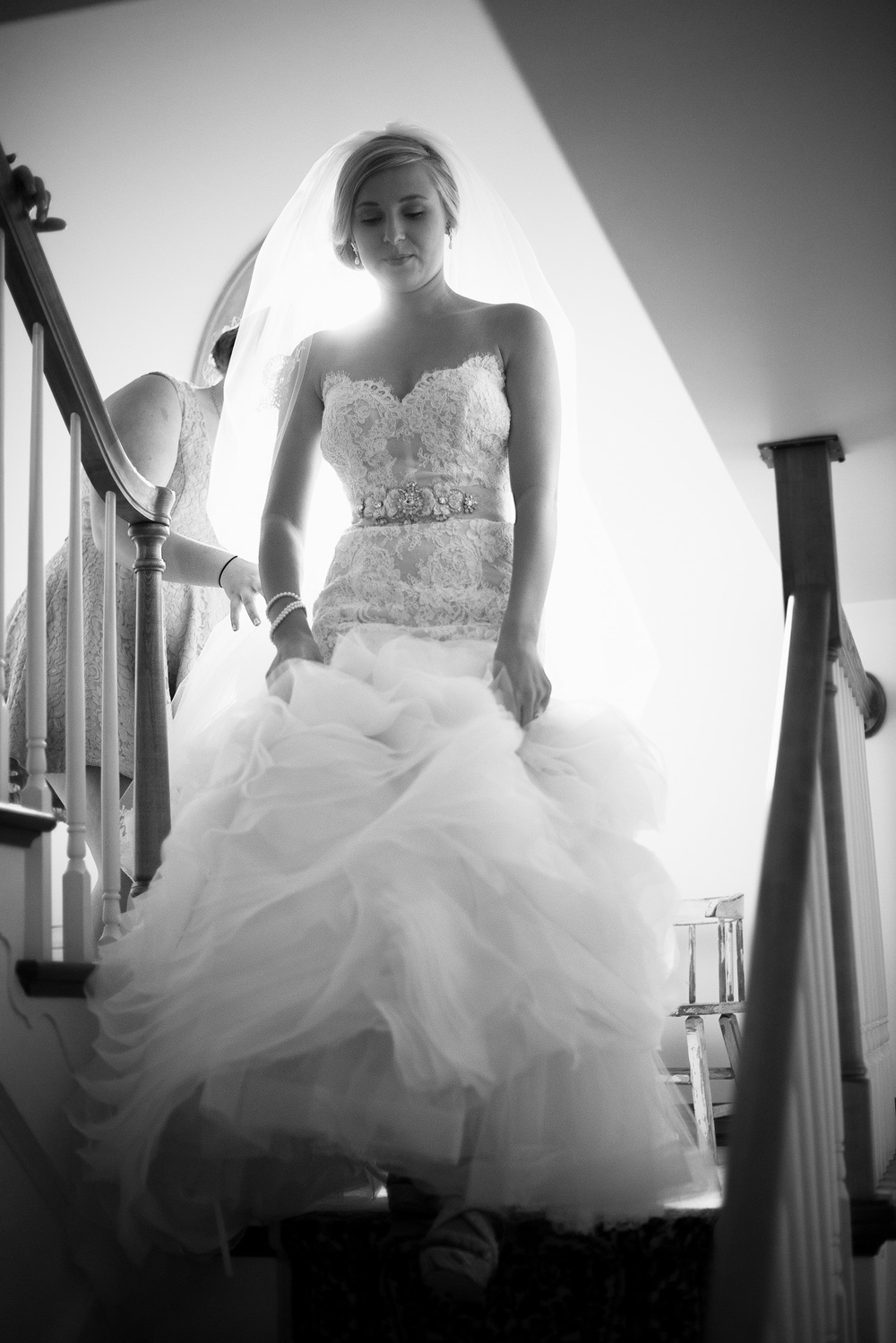 bride coming down stairs dress window light bw
