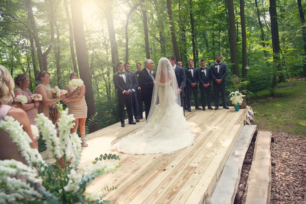bride groom ceremony sun flare outdoor rustic
