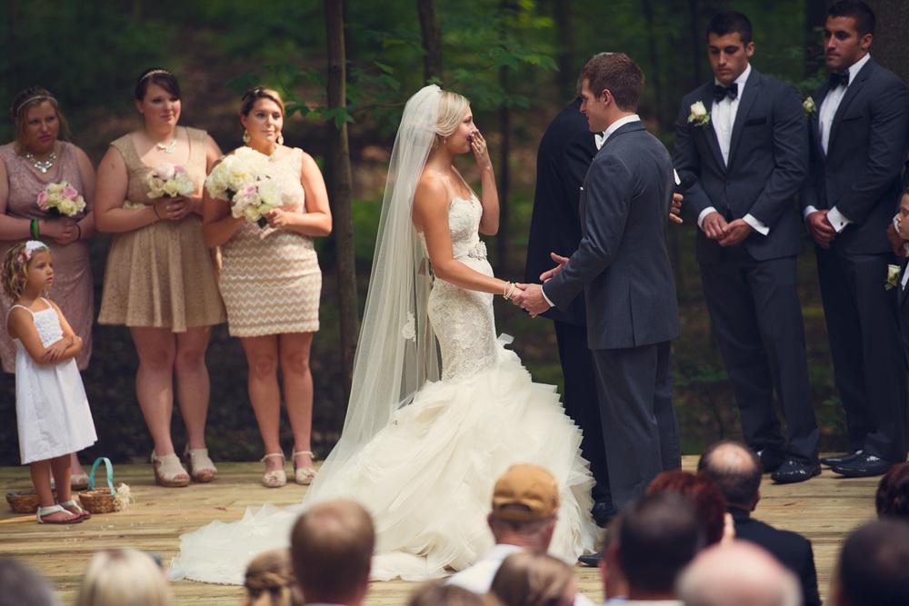 bride tears emotion groom ceremony outdoor rustic