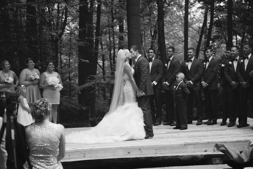 bride groom kiss husband wife ceremony outdoor rustic wedding bw