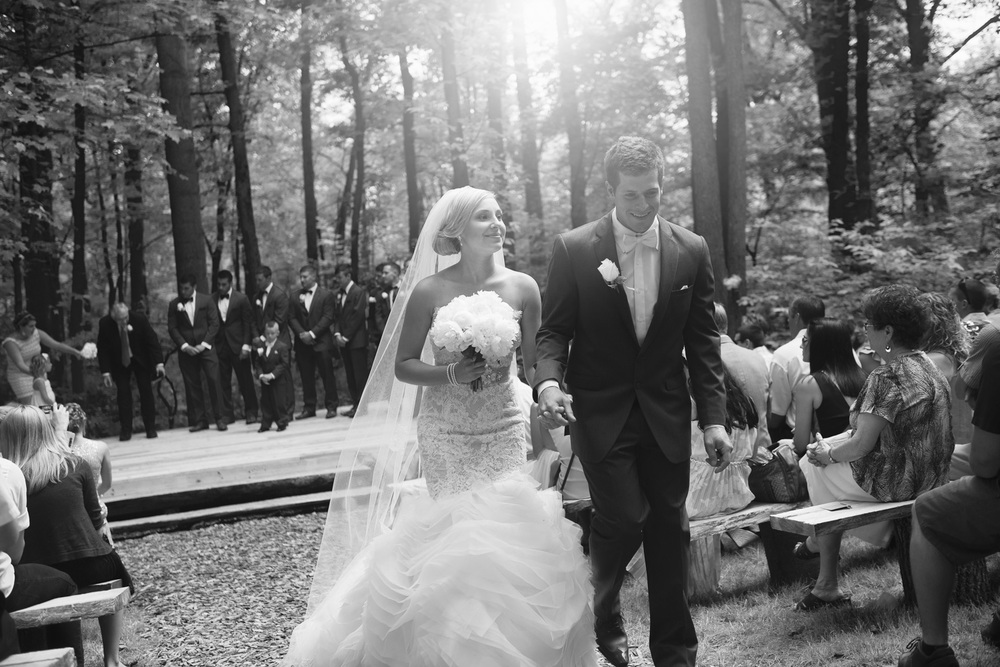bride groom sun flare husband wife ceremony outdoor rustic wedding bw