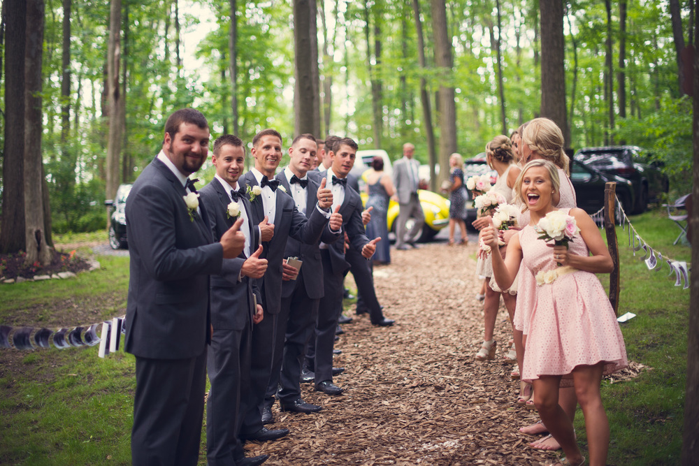 bridal party thumbs up outdoor rustic wedding