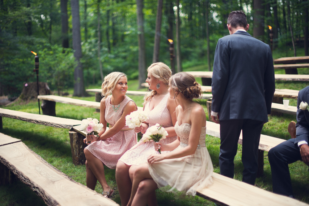 bridesmaids bridal party sitting outdoors rustic artistic