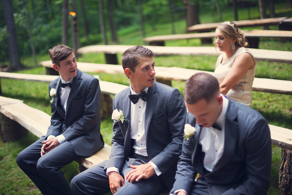 groomsmen bridal party sitting outdoors rustic artistic