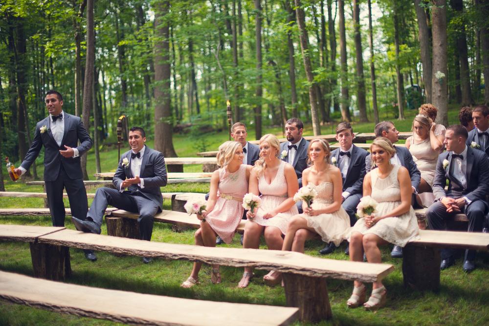 groomsmen bridesmaids bridal party sitting outdoors rustic artistic