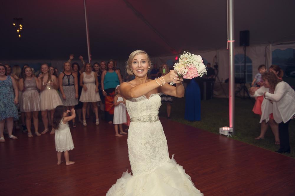 bride bouquet toss flowers dancefloor singles