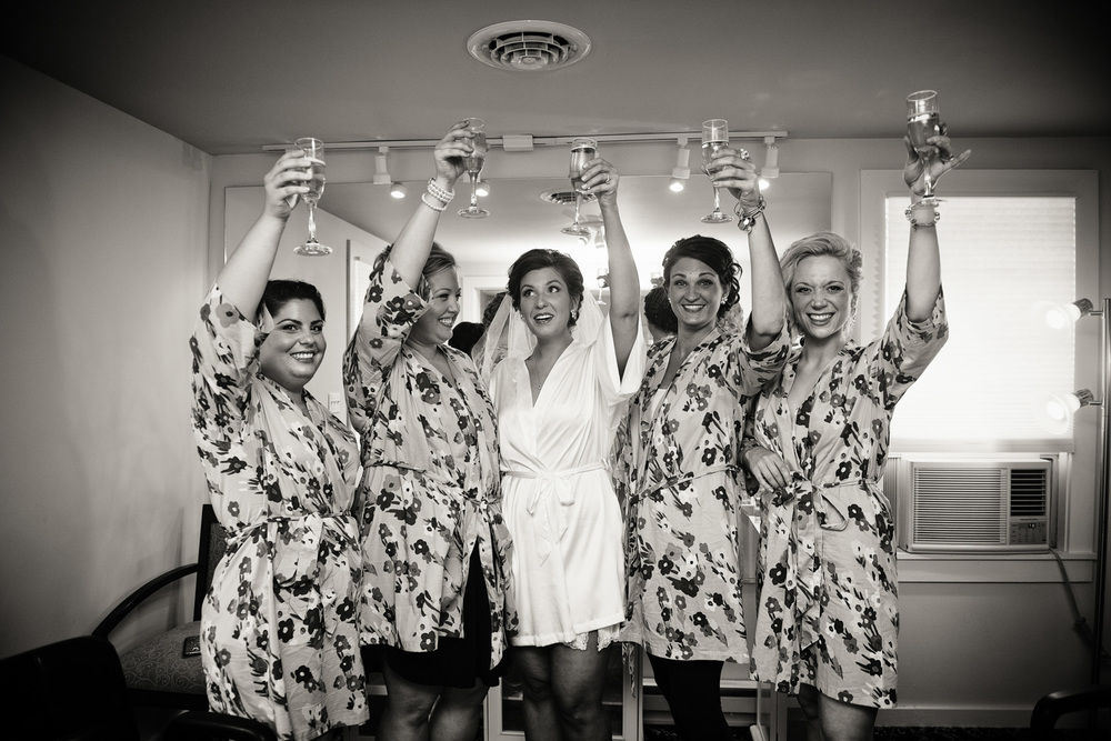 robes bride bridesmaids cheers toast bw portrait celebrate