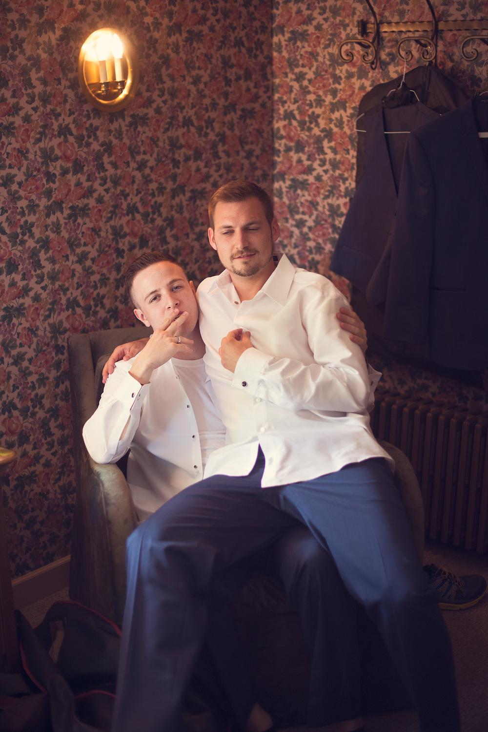 bros lap sitting groomsmen tuxedo