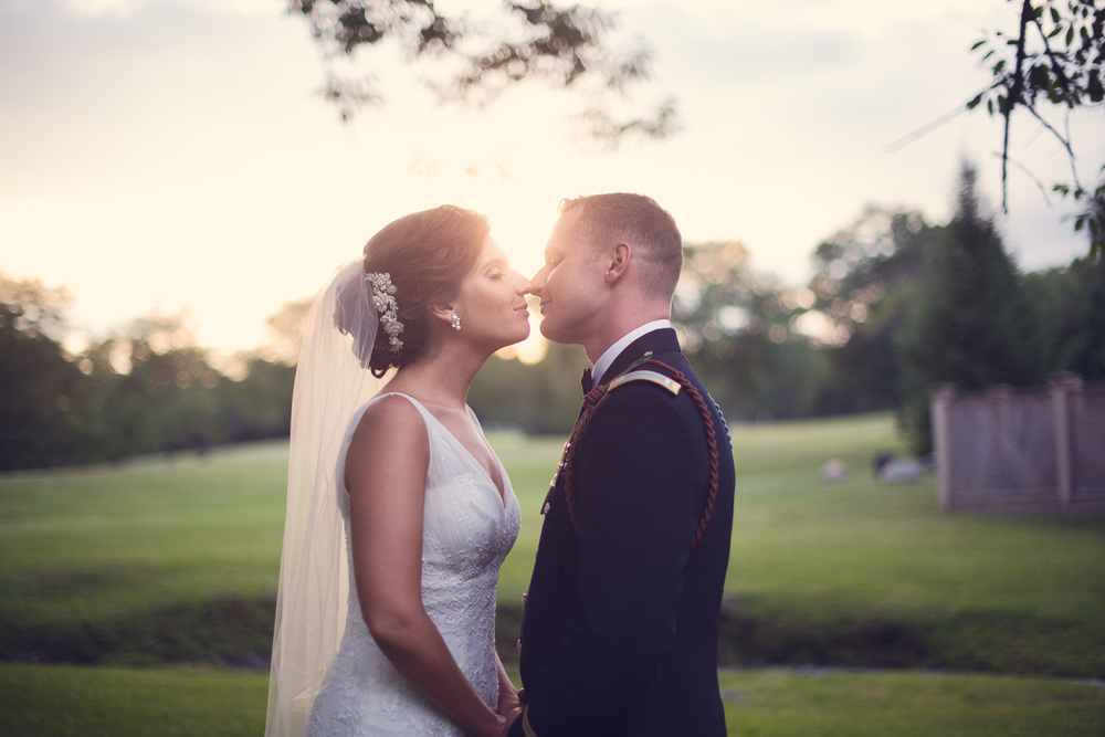 wedding bride groom army noses kiss husband wife marriage sunset portrait THPHOTO