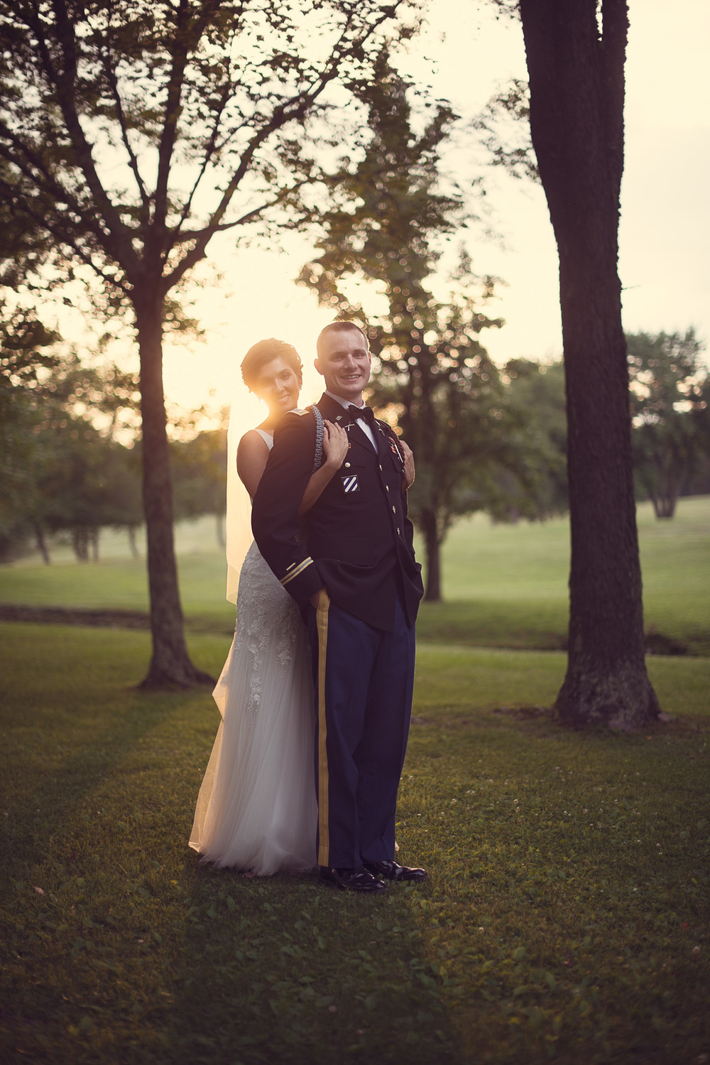 wedding bride groom army sun flare husband wife marriage sunset portrait THPHOTO