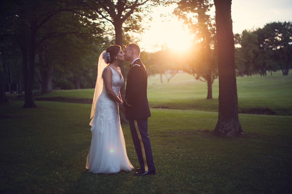 wedding bride groom army kiss sun flare husband wife marriage sunset portrait THPHOTO