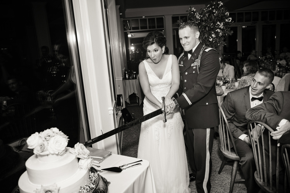 wedding reception cake cutting sword dessert army