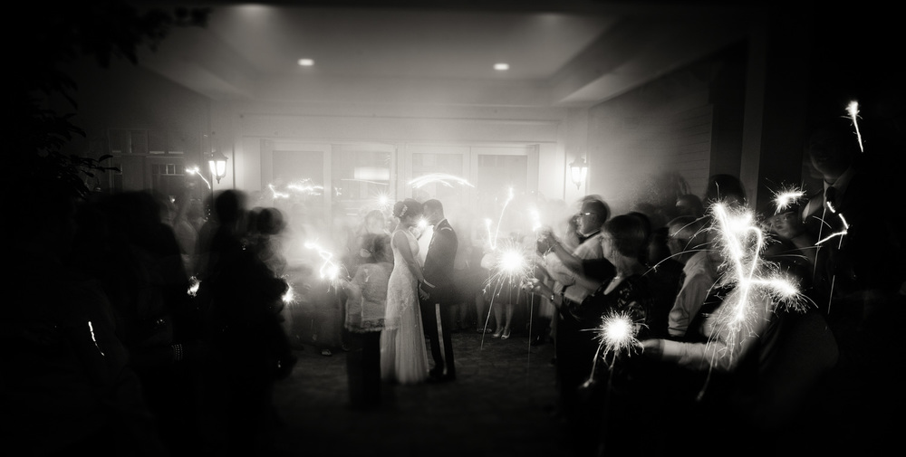 wedding bride groom husband wife marriage sparklers family bw magical long exposure