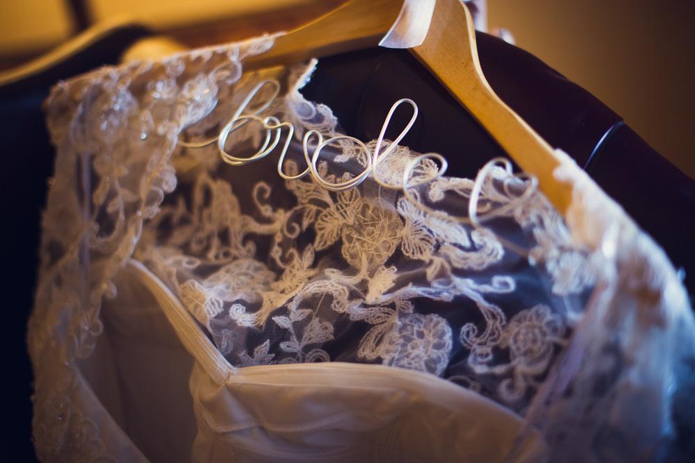bride hanger dress lace details closeup
