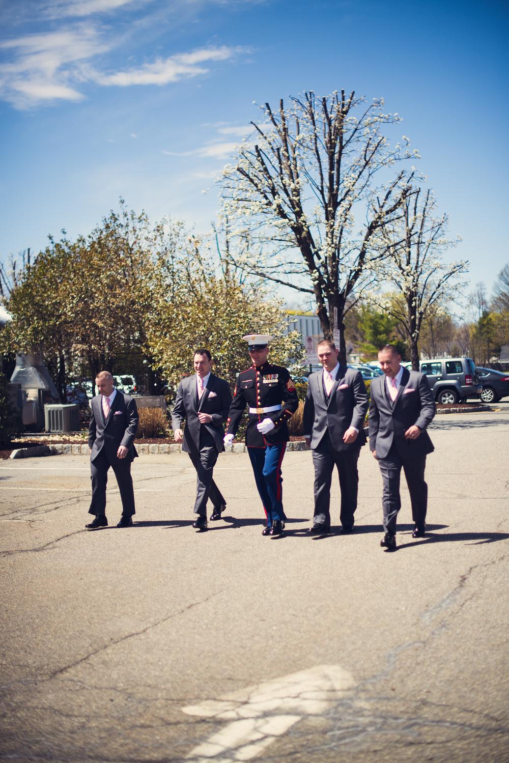 American Marine groom groomsmen walking outdoors
