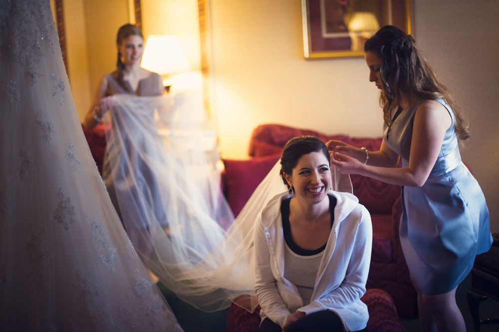 bride veil smiling getting ready candid