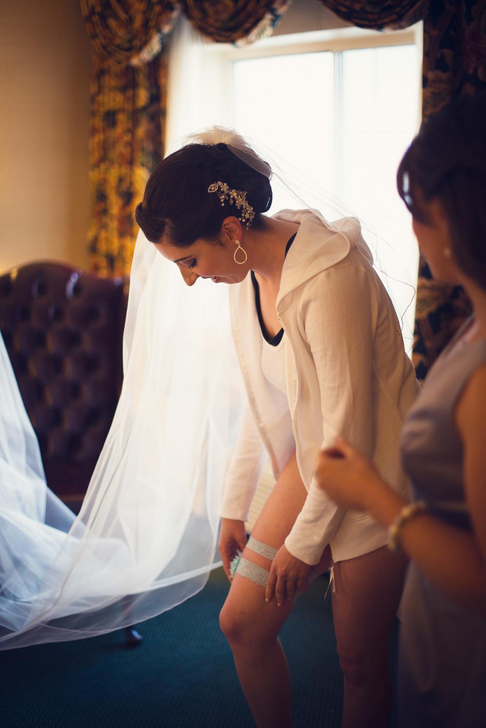 bride garter leg smiling getting ready