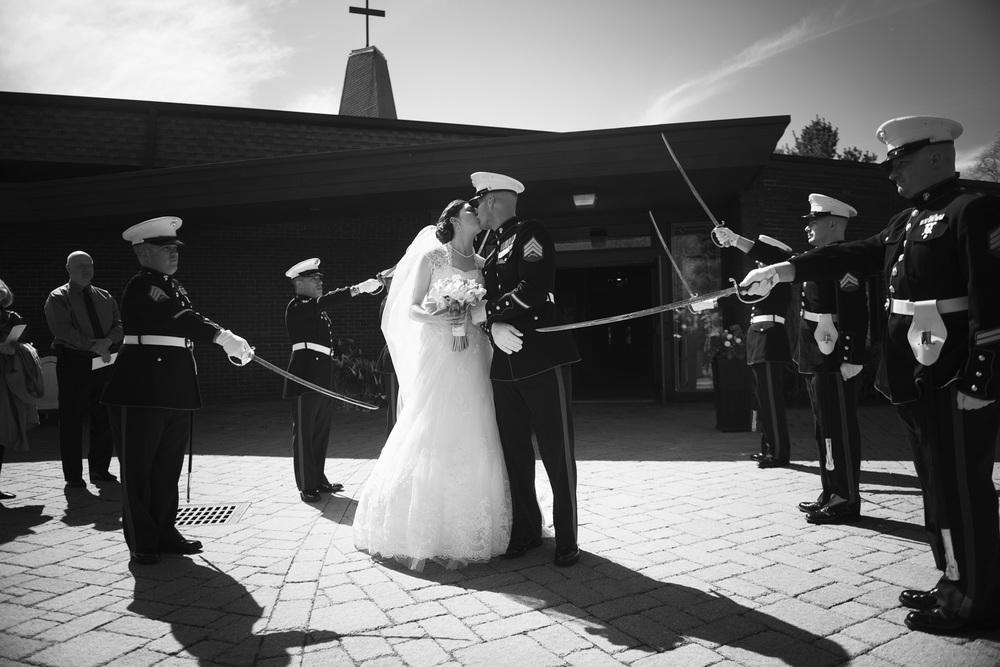 bride groom marine kiss husband wife couple married wedding portrait sword salute bw THPHOTO